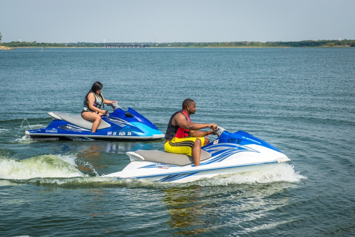 Jet skiers boy and girl